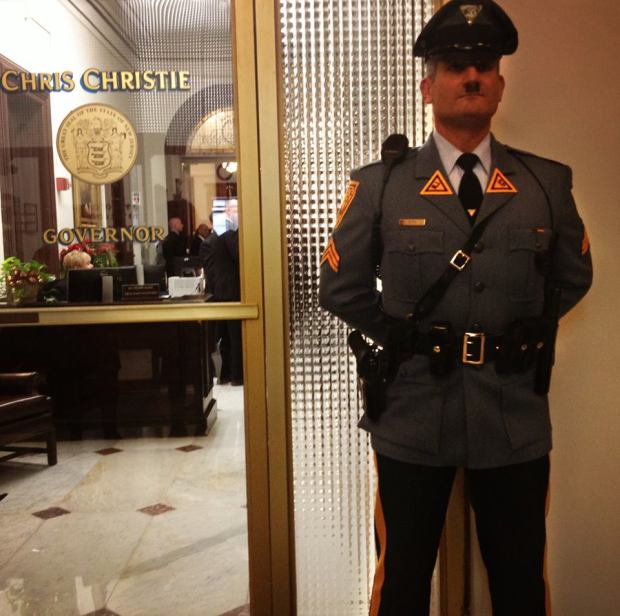 The New Face of the GOP, No Future for Democracy in their Amerika, as this armed Hitler-policemandoll in front of Chris Christie's Office of Govenor proves....