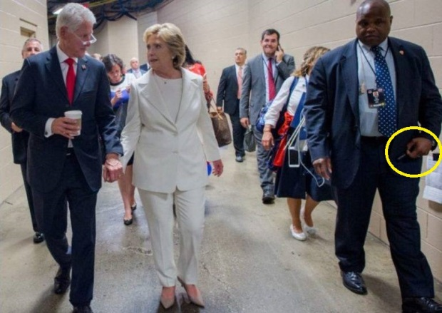 hillarys-body-guard-holding-diazepam-pen